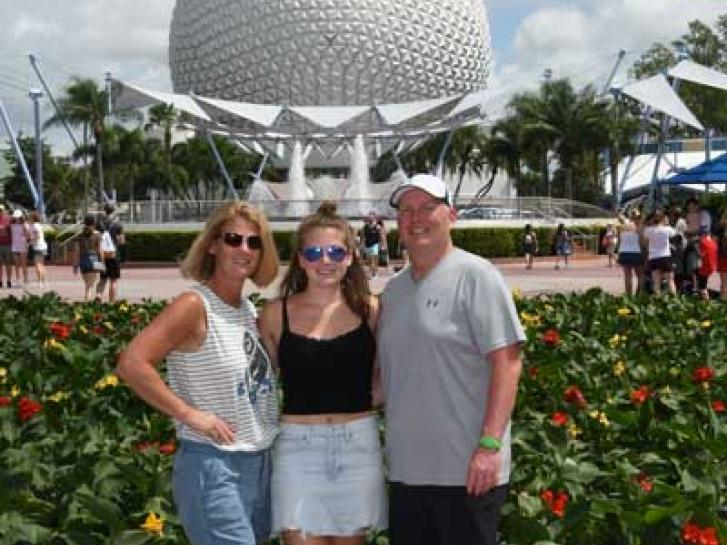 Guest Photo from Chuck: Guests in front of Spaceship Earth at Epcot