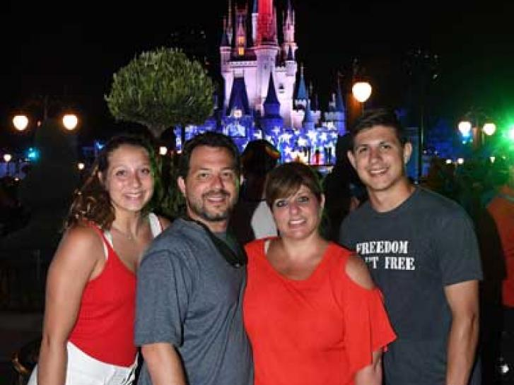 Guest Photo from Kim Castiglione: Guests in front of Cinderella Castle at the Magic Kingdom at night