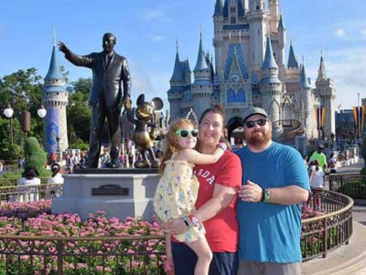 Guest Photo from Meg: Guests with Partners statue in front of Cinderella Castle at the Magic Kingdom