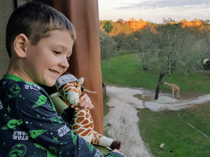 Guest Photo from Jan Perry: Guest on balcony at Animal Kingdom Villas