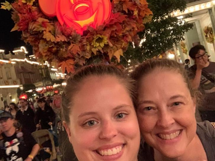 Guest Photo from Sheri Roberts: Guests in front of Halloween display at Walt Disney World