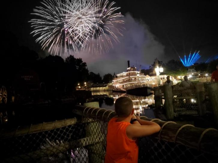 Guest Photo: Guests watching fireworks from Disney's Polynesian Villas
